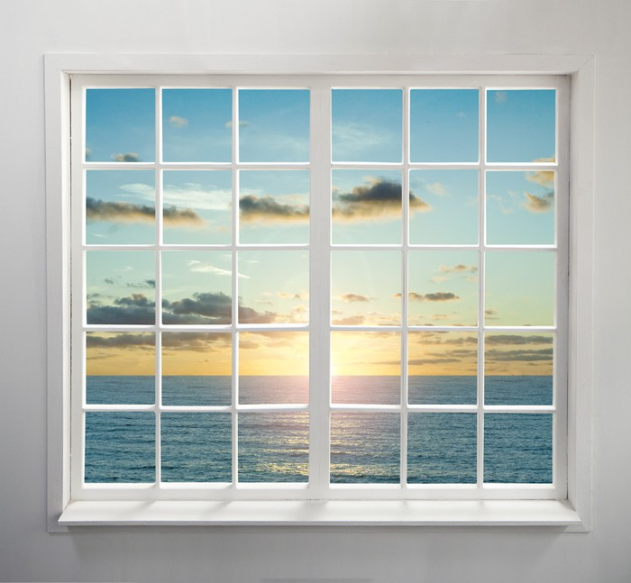 Modern residential window with sea view during sunset wall for Residential window walls