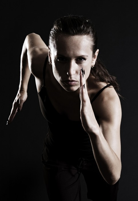 Tableau sur Toile Femme courir sur fond sombre - Santé