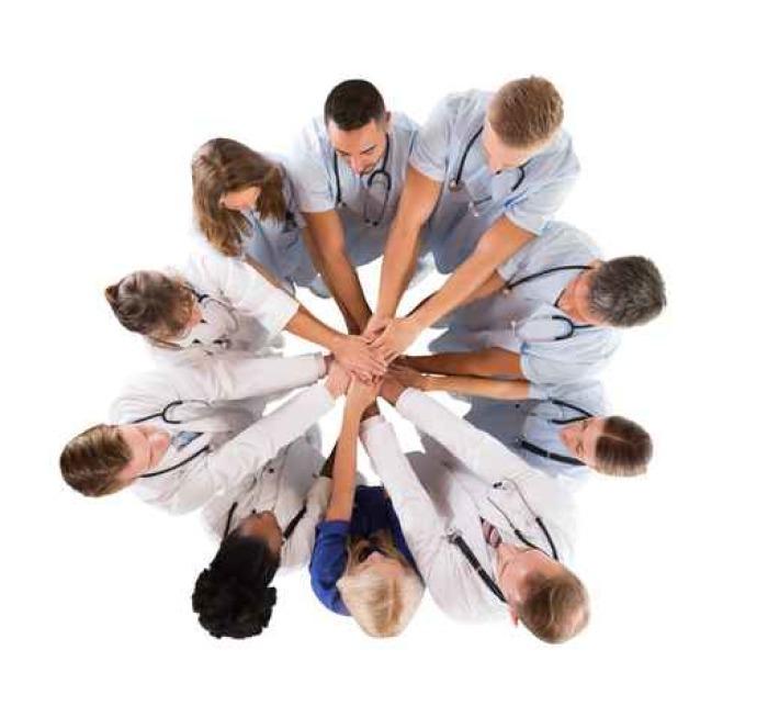 Vinylová Tapeta Přímo nad záběr mnohonárodnostní lékařský tým stohování Hands - Lidé